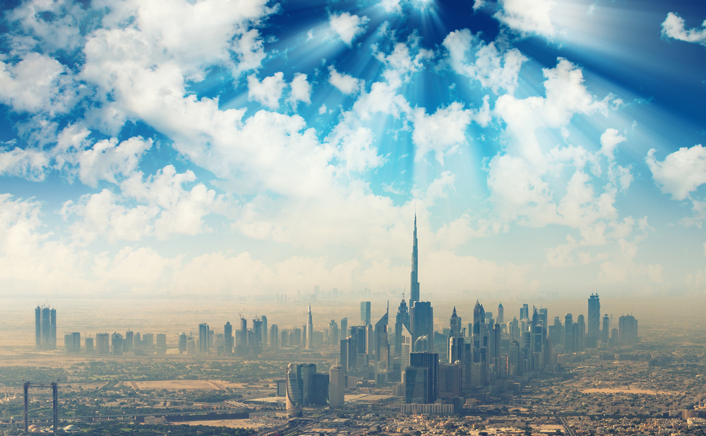 Which one sector alone contributes almost half to Dubai's economy?